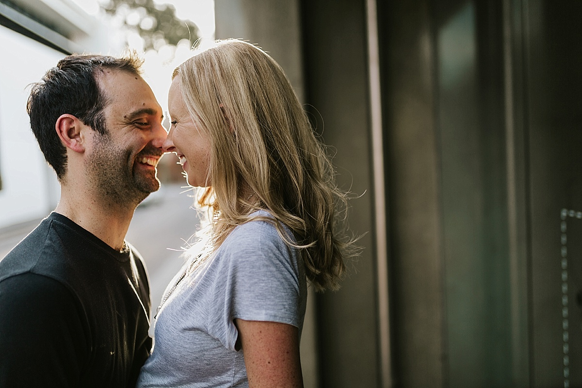 Jacquie&Hayden_Fun-Richmond-Urban-Engagement-Session-Relaxed-Candid_17